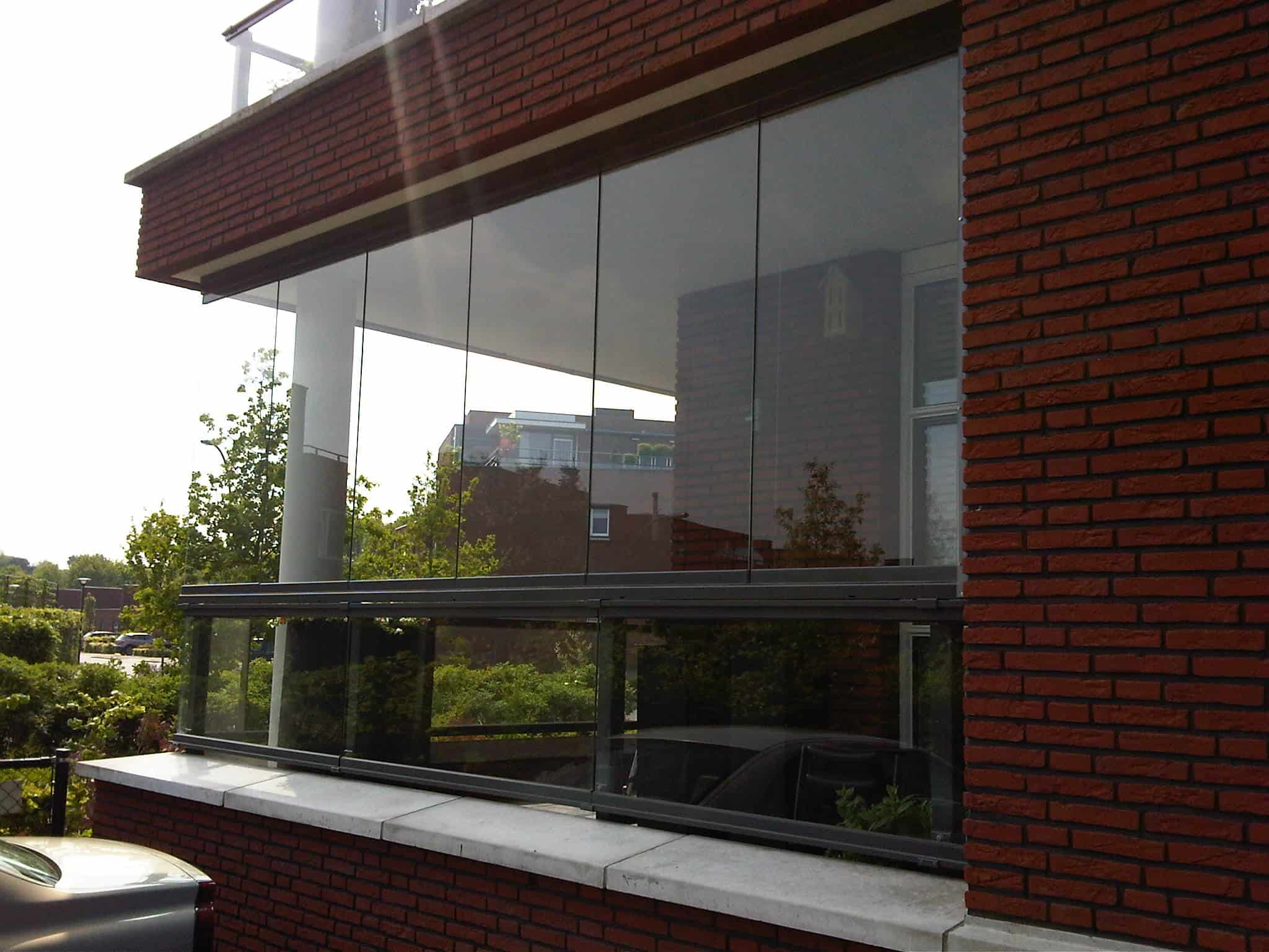 Glazen schuifwand balkon